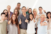 Grupo multiétnico pulgares arriba — Foto de Stock