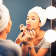 Woman Applying Make-Up - Stock Photo