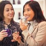Women Buying Aromatherapy Oil — Stock Photo #25308795
