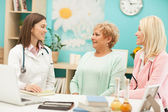 Doctor and Patients — Stock Photo