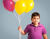 Boy Holding Balloons — Stock Photo