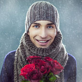 Man Holding Flowers — Stock Photo