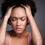 Woman with a Headache — Stockfoto