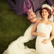 Stock Photo: Married Couple on Grass