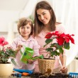 Mother and Daughter Watering Plants — Stock Photo #25348957