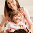 Mother and Daughter Planting — Stock Photo