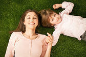 Mother and Daughter Lying on Grass — Stock Photo