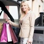 Smiling Woman Shopping — Stock Photo