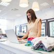 Shop Assistant at a Clothes Store — Stock Photo #34734907