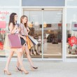 Two Smiling Women Window Shopping — Stock Photo #34734989