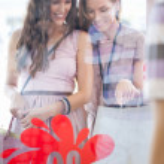 Two Smiling Women Window Shopping — Stock Photo #34735015