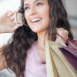 Stock Photo: WomTelephoning While Shopping