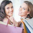 Two Smiling Women Shopping Together — Stock Photo #34735057