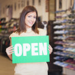 Shop Assistant Holding the 'Open' Notice — Stock Photo