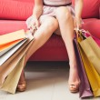 Woman Sitting With Shopping Bags — Foto de Stock