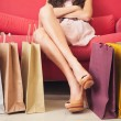 Foto Stock: WomSitting With Shopping Bags