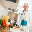 Senior Man Cooking at Home — Stock Photo