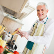 Stock Photo: Senior MCooking at Home
