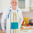 Senior Man Cooking at Home — Stock Photo #34735481