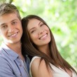 happy caucasian couple outdoors — Stock Photo