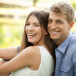 Outdoor portrait of a happy couple. — Stock Photo