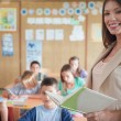 Smiling Teacher and Her Class — Stock Photo