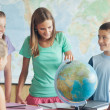 Schoolchildren in a Geography Lesson — Stock Photo #34737501