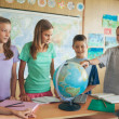 Schoolchildren in a Geography Lesson — Stock Photo #34737561