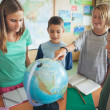 Schoolchildren in a Geography Lesson — Foto de Stock