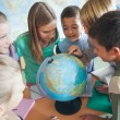 Schoolchildren in a Geography Lesson — Stock Photo #34737625