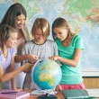 Stock Photo: Students in Geography Lesson