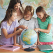 Students With a Globe — Stock Photo