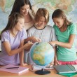 Students With a Globe — Stock Photo #34737743