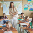 Stock Photo: Smiling Teacher and Her Students