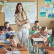 Smiling Teacher and Her Students — Stock Photo