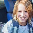 Smiling Schoolboy in the Car — Stock Photo