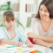 Stok fotoğraf: Mother and Daughter Doing Homework Together
