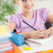 Smiling Girl Doing Homework at Home — Stock Photo