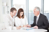 Couple With Their Financial Advisor — Stock Photo