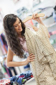 Smiling Woman Buying a Dress — Stock Photo