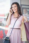Woman Telephoning While Shopping — Stock Photo