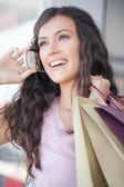 Woman Telephoning While Shopping — Stock Photo