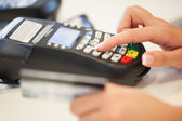Typing the Pin Code into the Card Reader — Stock Photo