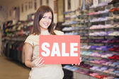 Shop Assistant Holding the 'Sale' Notice — Stock Photo