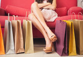 Woman Sitting With Shopping Bags — Stockfoto