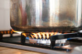 Saucepan on the Burner — Stock Photo
