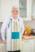Senior Man Cooking at Home — Stock Photo