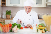 Chef Cutting a Tomato — Stockfoto