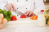 Chef Cutting a Tomato — Stock Photo