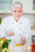 Chef Beating Eggs — Stock Photo